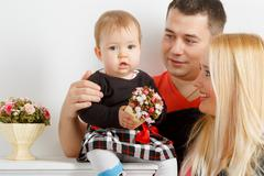 Happy young family, mom dad and little girl - stock photo