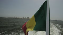 Senagelese Flag on the Back of a Ferry Waving in the Wind Stock Footage