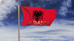 Albania flag with title waving in the wind. Looping sun rises style.  Animation Stock Footage