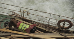 Man Sleeping on board a Ferry at the Autonomous Port of Dakar, Senegal (4K) Stock Footage