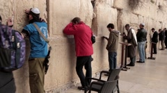 Orthodox religious Jew pray Wailing Western Wall of old city Jerusalem Steadicam - stock footage