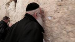 Orthodox religious Jew pray Wailing Western Wall of old city Jerusalem Steadicam Stock Footage
