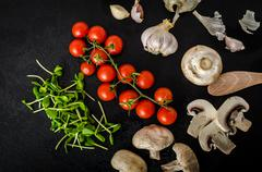 Bio garlic, spices and wild mushrooms from the home garden - stock photo