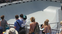 Crowds watch freestyle skateboarder Stock Footage
