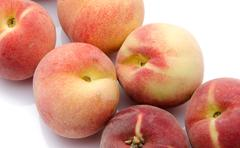 Ripe peaches aligned diagonally - stock photo