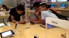 People playing new iphone inside Apple store - stock footage