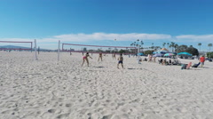 Women Play Volleyball On Beach- Long Beach California Stock Footage