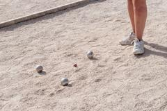 Metallic petanque balls on a fine gravel ground Stock Photos