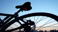 Modern Bicycle on the Evening Sunset with Enabled Red Signal Lamp. 4K Stock Footage