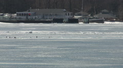 Dangerous thin ice in spring weather at Toronto skyline Stock Footage