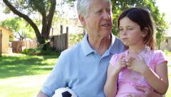 Grandfather & Granddaughter Grandchild Drinking Water Arkistovideo