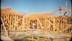 1887 - carpenters build framework for walls of new home -vintage film home movie - stock footage