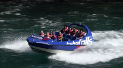 Hukafalls jet boat takes tourists on fast ride, Taupo, New Zealand Stock Footage