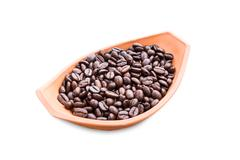 coffee beans in pottery bowl on white - stock photo