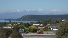 Zoom in to view of Lake Taupo and mountains, New Zealand Stock Footage