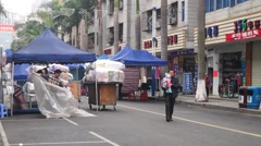 City peddlers, in Shenzhen, China Stock Footage