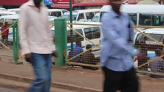 Driving by bus parking lot in rwanda city Stock Footage