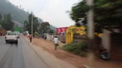 Driving past pedestrians in rwanda Stock Footage