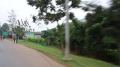 driving through rural rwandan village - stock footage
