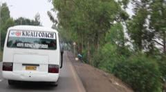 driving behind Kigali Coach bus - stock footage