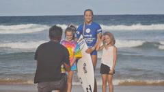 Female Hurley surf finalist joined by fans Stock Footage