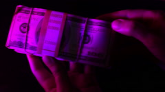 Money in UV light ultraviolet 1 Stock Footage