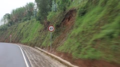 Passing Shot of Villages and Road Signs on Remote Rwandan Road in  Stock Footage