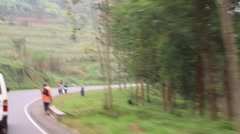 Beautiful, Lush Passing Scenery on Rwanda Road - stock footage
