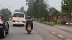 Vehicles, Motorcycles, Pedestrians on African Road  - stock footage