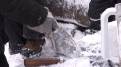 Close up of an artists carving ice cube during Toronto winter icefest Stock Footage