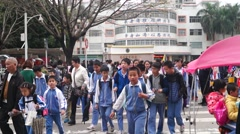 School in the afternoon after school, parents take their children home Stock Footage
