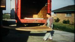 1894 - wood paneling delivered & unloaded for new home - vintage film home movie Stock Footage