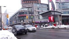 Toronto winter Yonge Dundas intersection traffic Stock Footage