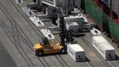 Reach stacker lifts container at Napier docks, New Zealand Stock Footage