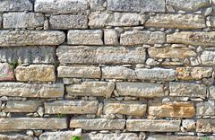 Fragment of an ancient wall from stones. (Background image) Stock Photos