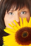 Young woman with a big sun flower Stock Photos