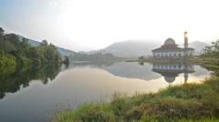 Beautiful Serene Morning At Lakeside Darul Quran Mosque. Pan Left Stock Footage