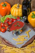 Tomato sauce in a white sauce boat with fresh ingredients Stock Photos