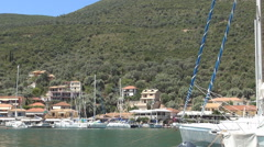 Yachts in Greece island harbor. Sailboats in a touristic port. Island Landscape. Stock Footage