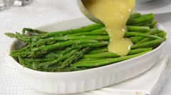 Asparagus and hollandaise sauce Stock Footage