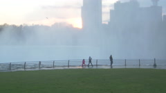 Tourists with kids running at Niagara Falls State Park - stock footage