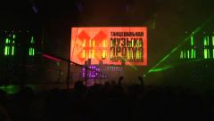 Big screen. Dj playing. Crowd hands up. Lasers and lights - stock footage