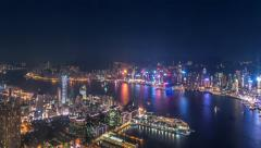 Aerial view of modern city at night - panorama of Hong Kong with illumination Stock Footage