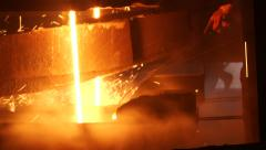 The liquid metal is poured into molds Stock Footage