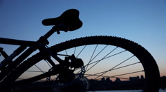 Male Hand Taking Bicycle on the Evening Sunset with Enabled Red Signal Lamp. 4K Stock Footage