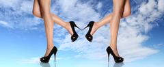 Woman legs with black shoes stiletto heel Stock Photos