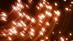 Orange glitter particles on black background falling loop. Stock Footage