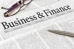 A newspaper with the headline Business and Finance - stock photo