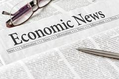 A newspaper with the headline Economic News - stock photo