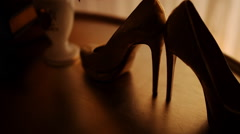 Bride shoes on a table by the window Stock Footage